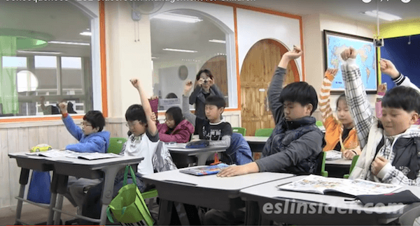 korean students raising their hands